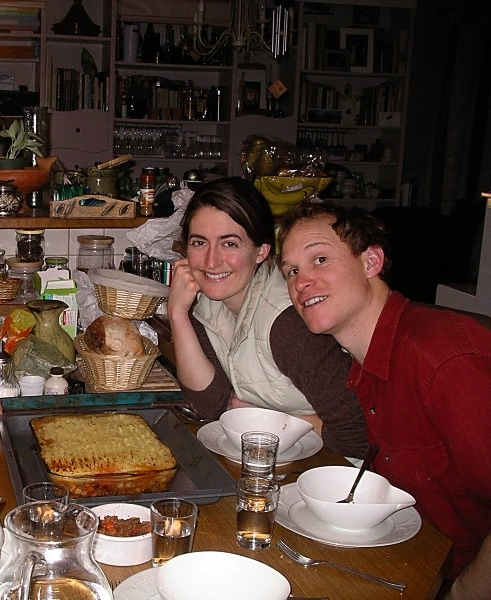 Amanda and I sitting down to dinner in France five years ago