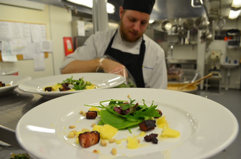 Smoked pork belly, local cheese, mixed greens, meadowsweet vinegrette.  Tommy the chef in the background.