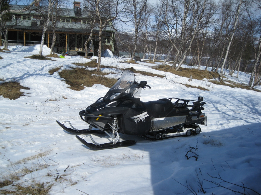 One of Saltoluokta's snowmobiles waiting at the ready.